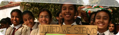 Indian girls with 'United We Stand' Sign