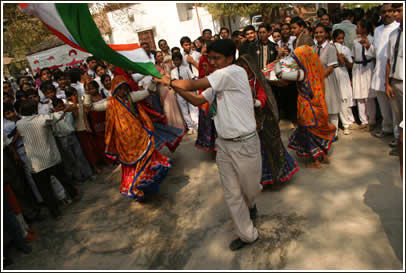 Kutchi dancers and a flag bearer rejoice in the name of friendship!