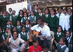 John Devaraj singing with children.